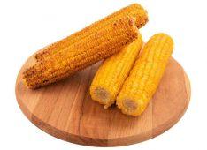 Три кукурузных початка на доске